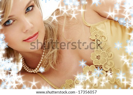 portrait of mysterious blue-eyed blond in pearls - stock photo