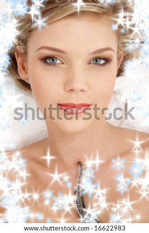 portrait of mysterious blue-eyed blonde with snowflakes - stock photo