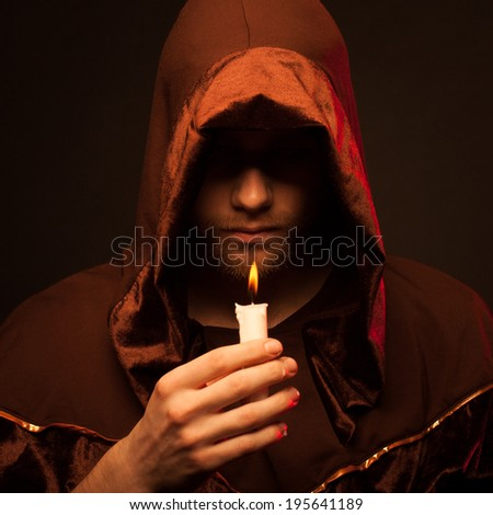 Portrait of mystery unrecognizable monk in robe - stock photo
