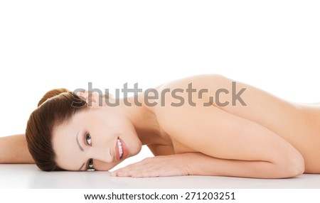 Portrait of naked woman lying on belly.