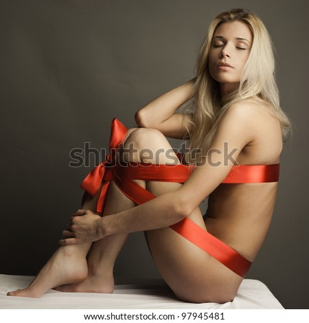 http://thumb7.shutterstock.com/display_pic_with_logo/200542/97945481/stock-photo-portrait-of-naked-woman-wearing-red-ribbon-as-lingerie-body-packaged-as-present-with-bow-97945481.jpg