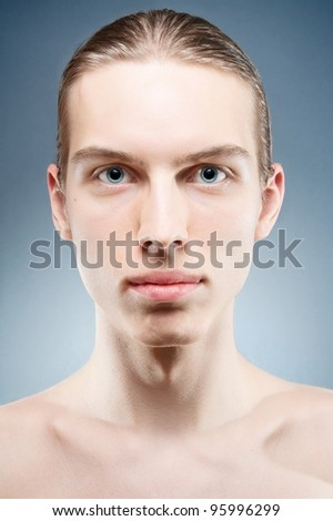 Portrait of naked young man with neutral expression. - stock photo