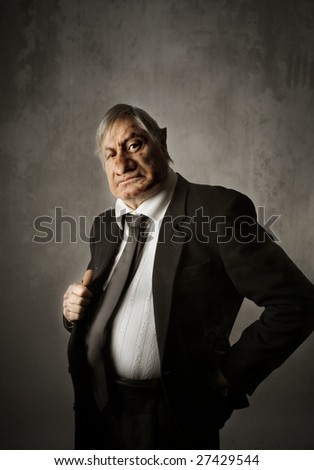 Portrait of nasty and bossy businessman - stock photo