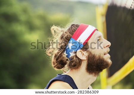 Portrait of natural looking beach volley ball player who is waiting on the net for the ball. - stock photo