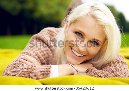 Portrait of natural smiling woman - stock photo