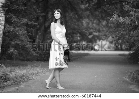 Portrait of naturally beautiful woman in her twenties, shot outside in natural sunlight