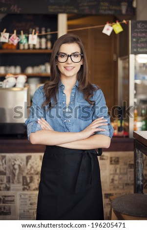 Portrait of nerdy waitress at work
