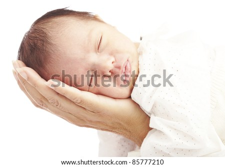 portrait of newborn baby and mother hand against a white background - stock photo