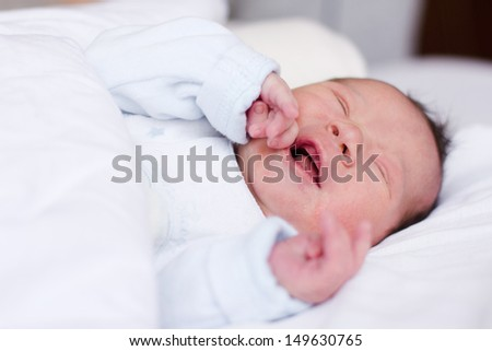 Portrait of newborn baby crying. - stock photo