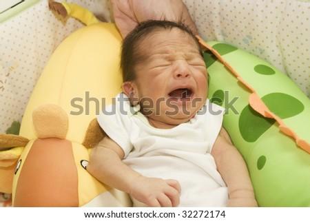 Portrait of newborn baby crying - stock photo