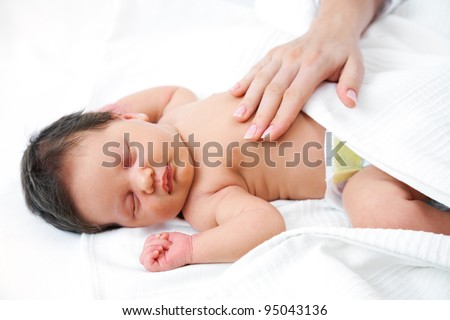 Portrait of newborn baby in careful mothers hands