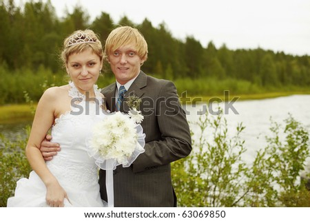 Portrait of newlyweds in an outdoor - summer - stock photo