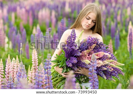 Portrait of nice beautiful girl in lupin field - stock photo