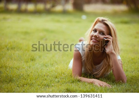portrait of nice beautiful woman calling by phone outdoors - stock photo