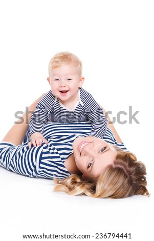 Portrait of nice boy with mother, little baby with mommy isolated on white background, pretty woman and cute cheerful child play game, happy smiling young lady hugging son, new family and love concept