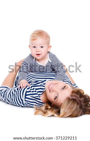 Portrait of nice boy with mother, little baby with mommy isolated on white background, pretty woman and cute cheerful child play game, happy smiling young lady hugging son, new family and love concept - stock photo