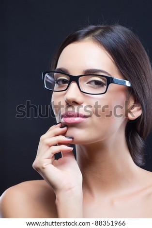 Portrait of nice brunette girl wearing optical glasses - stock photo