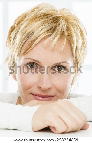 Portrait of nice, forty years old woman - stock photo