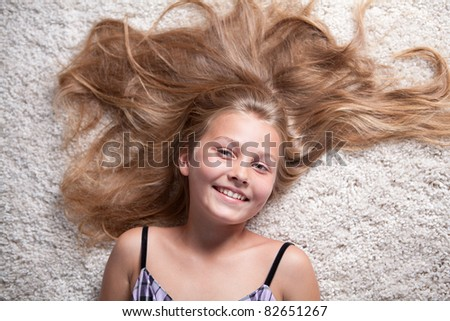 Portrait of nice girl with long hair. - stock photo