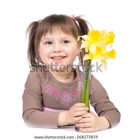 Portrait of nice little girl sitting at a table with a bouquet of yellow flowers, isolated on white background.