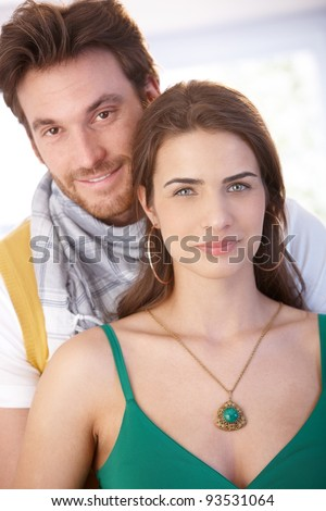 Portrait of nice young couple, embracing, smiling at camera.? - stock photo
