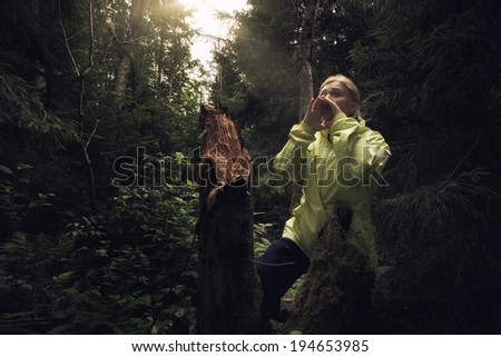 Portrait of nice young girl hanging out in the wood