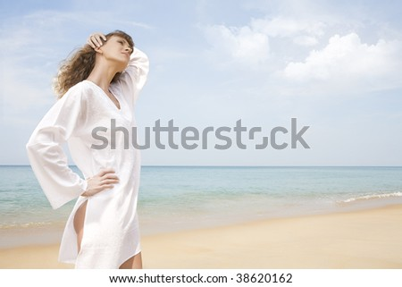 Portrait of nice young woman having good time on the beach