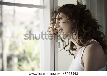 portrait of nice young woman in domestic environment - stock photo
