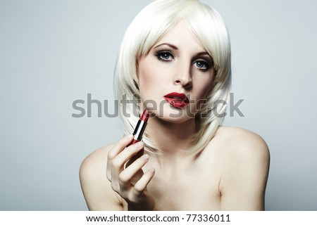 Portrait of nude elegant woman with blonde hair and red lipstick