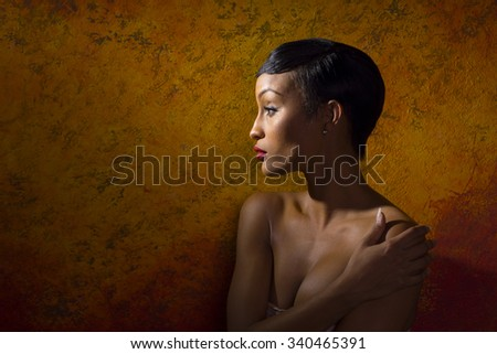 Portrait of nude female model covering her chest - stock photo