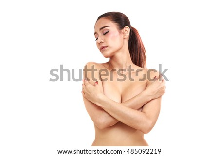 Portrait of nude woman covering her breast. Perfect woman body .white isolated