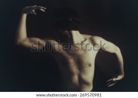 Portrait of nude young men blindfolded on a black background - stock photo