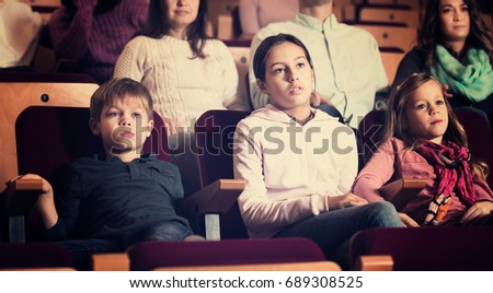 Portrait of number of people enjoying film screening in cinema
