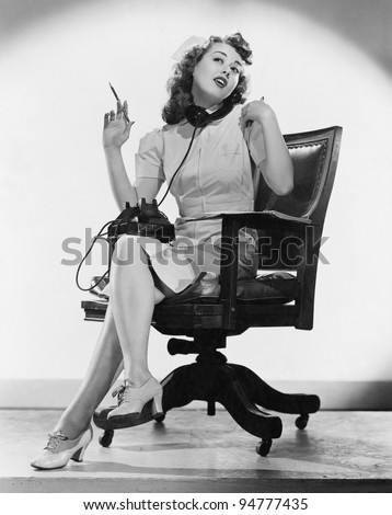 Portrait of nurse talking on telephone - stock photo