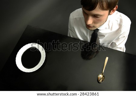 Portrait of office manager eating petroleum - stock photo