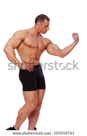 Portrait of old bodybuilder posing in studio - stock photo