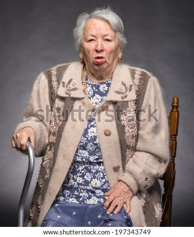Portrait of old coughing woman