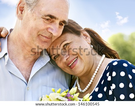 Portrait of  old couple  at summer  outdoor. - stock photo
