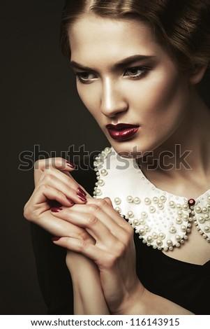 portrait of old-fashioned beautiful woman - stock photo