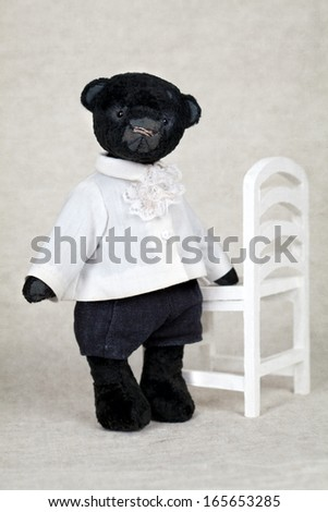 portrait of old fashioned teddy bear, handmade - stock photo