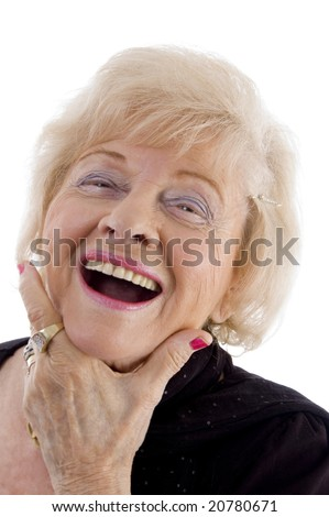 portrait of old female holding her face on an isolated background - stock photo