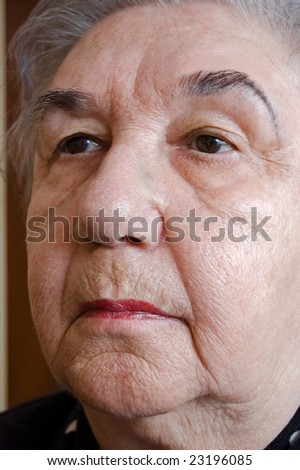 Portrait of old lady reflecting on her entire life. - stock photo