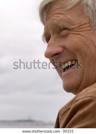 Portrait of old man laughing - stock photo