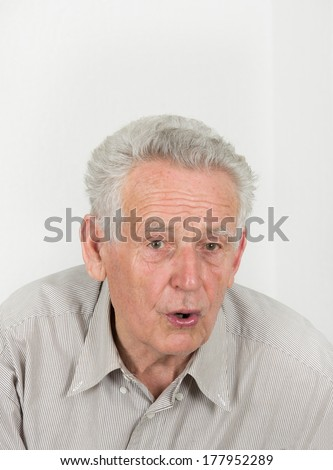 Portrait of old man who is surprised - stock photo