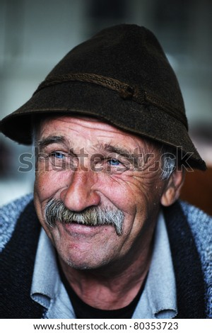 Portrait of old man with mustache - stock photo