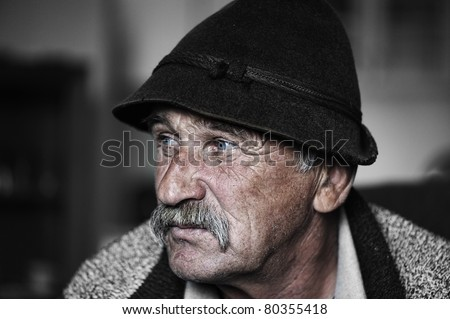 Portrait of old man with mustache, grain added - stock photo