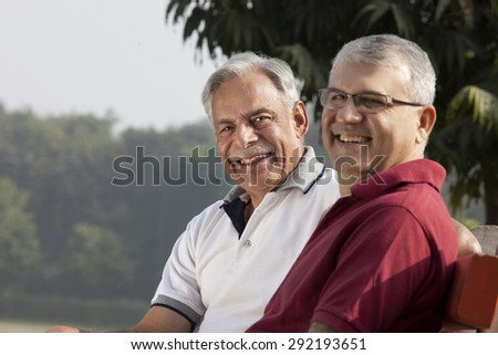 Portrait of old men in a park - stock photo