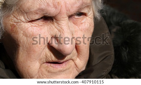 Portrait of old talking woman. Close-up
