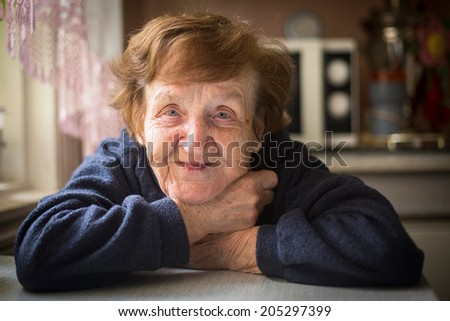 Portrait of old woman close up. - stock photo