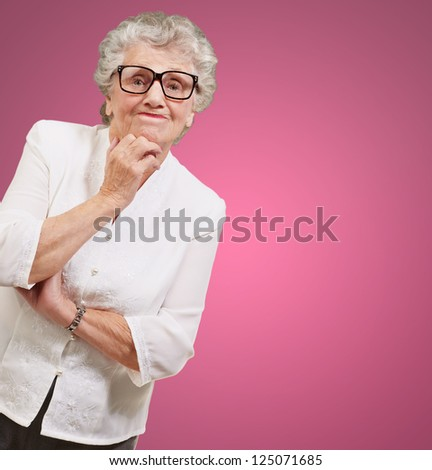 Portrait Of Old Woman On Pink Background - stock photo